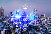 Hologram of Research and Development glowing icons. Sunset panoramic city view of Bangkok. Concept of innovative technologies to create new services and products in Asia. Double exposure.
