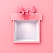 Blank gift box showcase display with pink ribbon bow isolated on pink pastel color wall background minimal conceptual