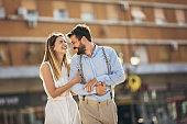 Couple in love walking embracing in street on romantic trip
