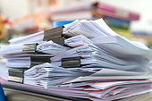 Office organize document paperwork of pile chaos tower papers, A lot of work papermess financial on stack of paper file report in business papers, Documents achieves education with clips workplace