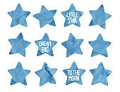 """Watercolor collection of five pointed navy blue stars and handwritten words: """"Little Star"""", """"Dream Big"""", """"To The Moon"""". Hand painted water color graphic drawing, cut out elements for creative design."""