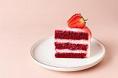 slice of red velvet cake with fresh strawberries