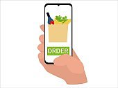 hand holds a smartphone and orders food in the application. secure contactless delivery and shopping concept