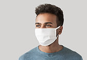 Portrait of a young man wearing protective face mask
