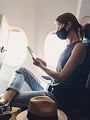 Woman traveling during pandemic wearing face mask