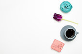 Gift box, cup of coffee, tulip flower, string on white background. flat lay, top view, copy space