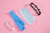Medical protective mask, antiseptic and rubber gloves and protective glasses.