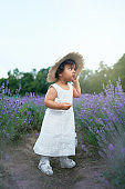 Adorable little girl posing in lavender field.