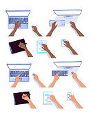Hands with computers and tablets