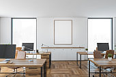 Mockup canvas in office room with chairs and computers on table, wooden design