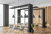 Wooden office coworking interior with minimalist furniture and windows
