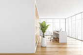 Mockup copy space in wooden reception room with desk and panoramic windows