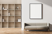 Beige living room interior with seat and bookshelf, mock up