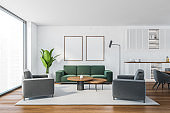 Mockup canvas in white living room with grey and green furniture