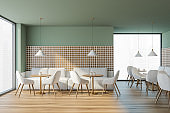 Modern cafe interior with wooden table and chairs, panoramic windows