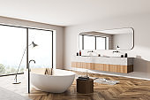 Bathroom interior with two sinks and windows on countryside