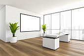 Close up of a CEO office interior with a wooden table, a computer standing on it, a framed poster on a white wall. 3d rendering, mock up