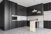 Dark wooden kitchen set in studio apartment with grey marble floor