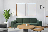 Mockup canvas in white living room with green sofa and table on carpet
