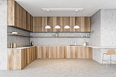 Wooden minimalist kitchen corner with lamps, stove and sink