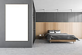 Mockup frame bed and linens in grey and wooden bedroom with wardrobe