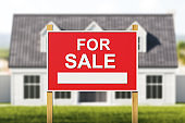 House for sale, red sign in front of blurred modern big building on grass