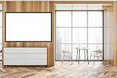 Wooden cafe interior with two seats and table near window, mockup poster