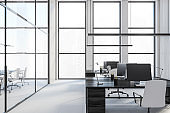 Office tables with computers view on the city, office room with big windows