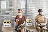Two Women Wearing Masks Waiting