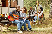 Young People Camping with RV