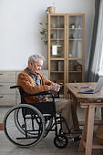 Senior Man in Wheelchair at Home