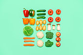 Vegetables and fruits symmetry, isolated on a colored background, top view. Healthy food concept