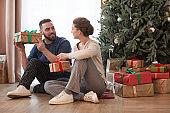 Couple Unpacking Christmas Presents