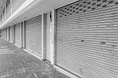 Closed steel shutter door of warehouse, storage or storefront for metal door background and textured.