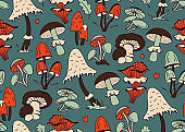 Hand-drawn vector seamless pattern with mushrooms in orange, beige, brown and green on a dark background