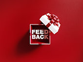 Feedback Text Coming Out Of A White Gift Box Tied With Red Ribbon