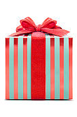 A box of striped gift wrapped in red ribbons
