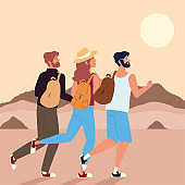 backpackers walking desert