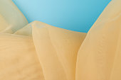 Yellow color tulle fabric texture  with beautiful closeup and elegance detail fabric background