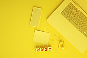 2022 New Year, Empty Screen Smartphone and Laptop on Yellow Background