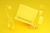 2022 New Year, Flying Blank Screen Laptop and Smart Phone on Yellow Background