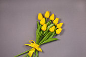 Bouquet of Yellow tulips over grey background