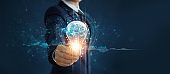 Businessman holding light bulb and brain inside, Idea and imagination, Creative and inspiration, Science innovation with network connection, Solution analysis and development, Innovative technology.