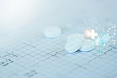 Medicine and heath concept. Pills and icon network medical heath care on doctor heart rate report background.
