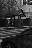 Few people are waiting on bus stop