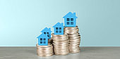 Model of detached miniature house mock up on coin