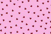 . A pattern of sparkling, iridescent hearts. Blank for the designer.