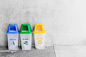 General Waste blue Wet Garbage green and Recycle Waste Yellow trash bin with space for text.
