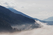 Beautiful mountain landscape. Sky with clouds and fog on the hills