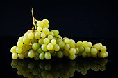 Green Grapes on Black Background with Reflection